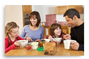Family Eating Breakfast In Energy Efficient Home